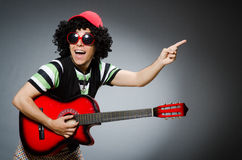 Man with funny haircut. And guitar Royalty Free Stock Photos