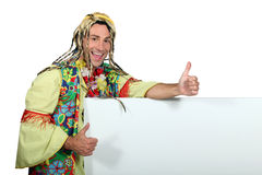 Man in funny hippy costume. With a blank board ready for your message Stock Photos