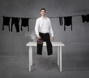 Man funny ironing clothes Royalty Free Stock Images