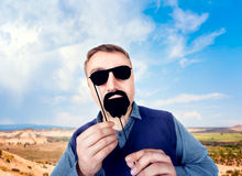 Man with funny sunglasses and beard on a stick Stock Photography