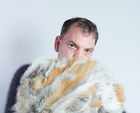 Man and fur coat Stock Images