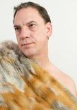 Man and fur coat Stock Image