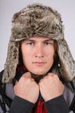 Man in a fur hat stock images