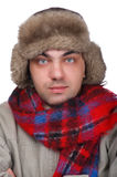 Man in a fur hat close up. People on white - man in a fur hat Stock Images