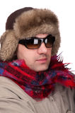 Man in a fur hat with sunglasses. People on white - man in a fur hat Royalty Free Stock Image
