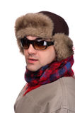 Man in fur hat with sunglasses. People on white - man in a fur hat Royalty Free Stock Photo
