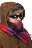 Man in fur hat with sunglasses close up. People on white - man in a fur hat Royalty Free Stock Photo