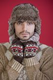 Man in fur hat and sweater Stock Images