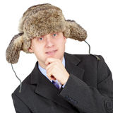 Man in a fur hat on white background Stock Images