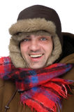 Man in a fur hat on white background Stock Photos