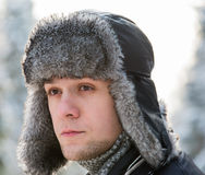 Man in a fur winter hat Stock Photos