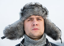Man in a fur winter hat Stock Image
