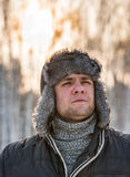 Man in a fur winter hat Royalty Free Stock Image