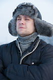 Man in a fur winter hat Royalty Free Stock Images