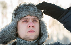 Man in a fur winter hat Royalty Free Stock Photo