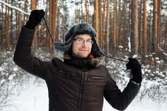 Man in fur winter hat with ear flaps smiling Stock Photos