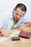 Man furbishing wooden planck Stock Image