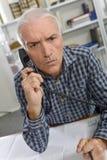 Man furious on phone Stock Photography