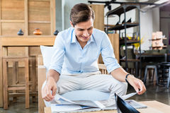 Man in furniture store  browsing catalog Stock Image