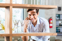 Man in furniture store talking on phone Stock Image