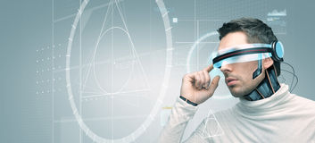 Man with futuristic 3d glasses and sensors Royalty Free Stock Image