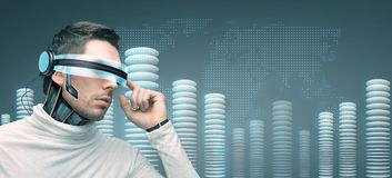 Man with futuristic 3d glasses and sensors. People, technology, future and progress - man with futuristic 3d glasses and microchip implant or sensors over blue Royalty Free Stock Photo