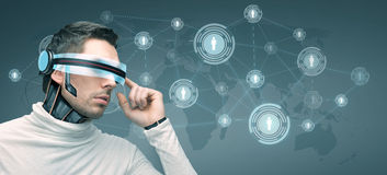 Man with futuristic 3d glasses and sensors Stock Photography