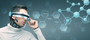 Man with futuristic 3d glasses and sensors Stock Images