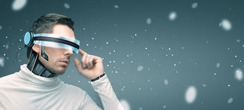Man with futuristic 3d glasses and sensors Stock Image