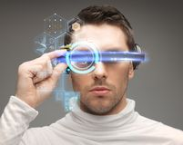 Man in futuristic glasses Stock Images