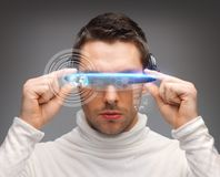 Man with futuristic glasses Royalty Free Stock Photography