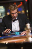 Man gambling at roulette table. In casino Royalty Free Stock Images