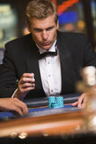 Man gambling at roulette table in casino Stock Photography