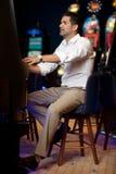 Man gambling at slot machine Royalty Free Stock Photos