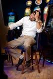 Man gambling at slot machine Stock Photos