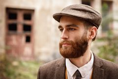 Man gangster in a cap and beard close-up royalty free stock photo