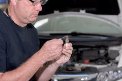 Man gaps a spark plug for a car Royalty Free Stock Photography