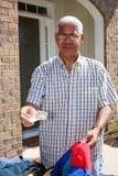Man At Garage Sale. Hispanic man buying something at a garage sale Stock Photo