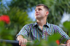 Man in a garden looking away Royalty Free Stock Photo