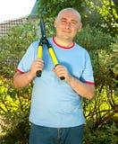 Man with garden pruner Royalty Free Stock Photo