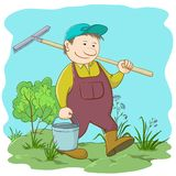 Man gardener in a garden. Man gardener with a bucket and a rake work in a garden Royalty Free Stock Photography