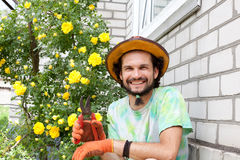 Man gardener with secateurs Stock Photography
