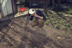 Man gardening in his back yard stock photos