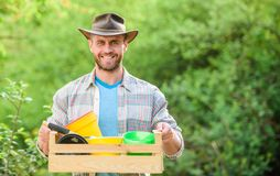 Man gardening. sexy farmer hold wooden box with flower pot. Eco farm worker. happy earth day. Eco living. farming and stock photos