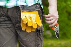 Man with gardening shears stock photo