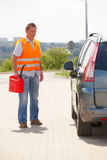 Man with gas can Stock Photography