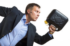 Man with gas can needs urgent fuel. A man in business clothes with a gas can is hasty running to get fuel stock photo