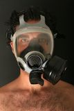 Man with gas mask. Mystery man wearing gas mask stock photos