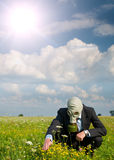Man in the gas mask. On a green field stock photos