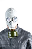 Man in Gas Mask. Men wearing a biker jacket and gas mask simbolizing danger in the environment Stock Photography